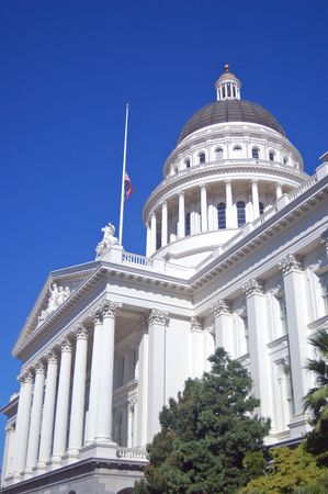 mast: California Capitol Building with flag at half mast