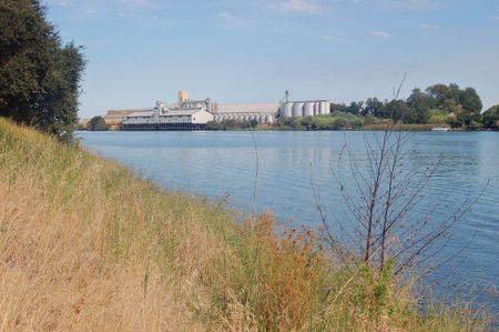 california delta: Grain storing depot along the Sacramento River Delta, California. Stock Photo