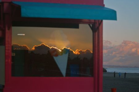 ice cream stand: reflection of the sunset on an ice cream stand at the boardwalk in Santa Cruz, California