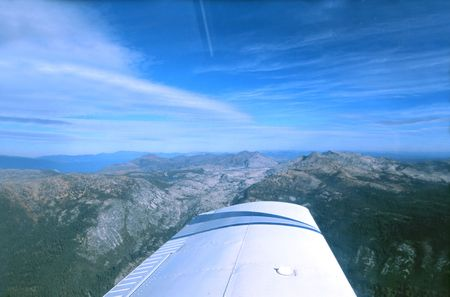 northern light: View of the northern Sierra Skyline from a  light single engine airplane, flying up to lake Tahoe Stock Photo