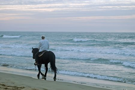into: riding into the sunset on the beach
