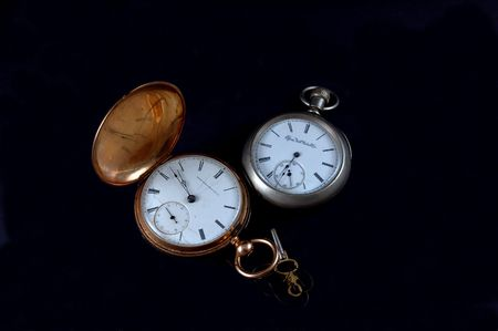 a couple gold and silver vintage pocketwatches photo