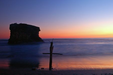 wooden cross on the beach at sunset Reklamní fotografie