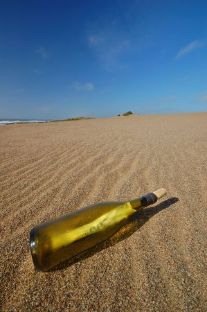 bottle with a message in it on the beach photo