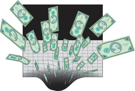 gastos: dinero siendo arrastrada hacia un agujero negro