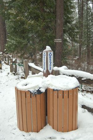 wooden garbace cans, or recycling bins, in the snow