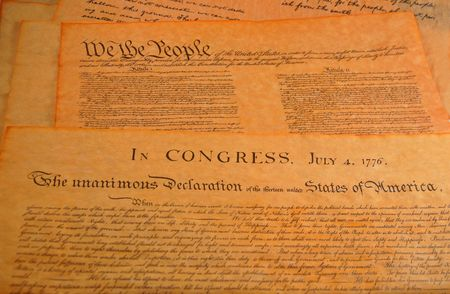 Declaration of independence and the Preamble to the Constitution in the background photo