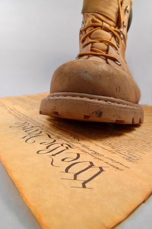 Boot of oppression stepping on the U.S. Constitution Stock Photo