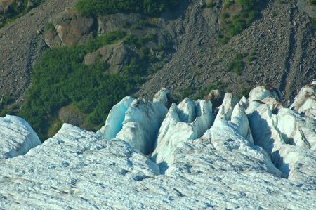 mighty glacier advances down a mountain valley in the Pacific Northwest United States