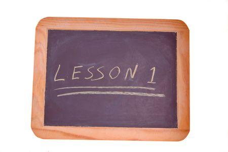 literacy instruction: lesson one written on chalkboard