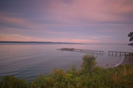 puget: Pier at sunset on the Puget Sound in Washington State Stock Photo