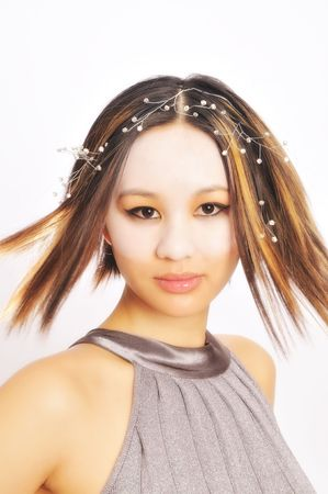 Pretty young Asian woman turning her head around flipping her hair Archivio Fotografico