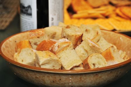 munchy: Bread as part of a meal with a bottle of wine in the background