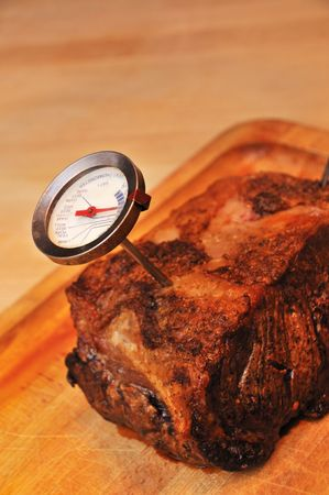 Roast beef for dinner with thermometer