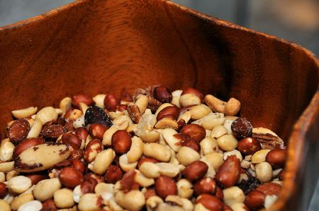 munchy: assorted nuts in a wooden bowl at a party