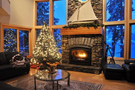 livingroom of an upscale house in winter with a fire in the fireplace