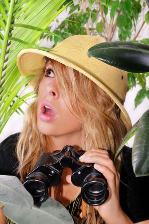 way out: beautiful young woman lost in the jungle looking for a way out Stock Photo