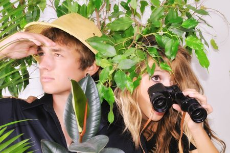 way out: young couple lost in the jungle looking for a way out Stock Photo