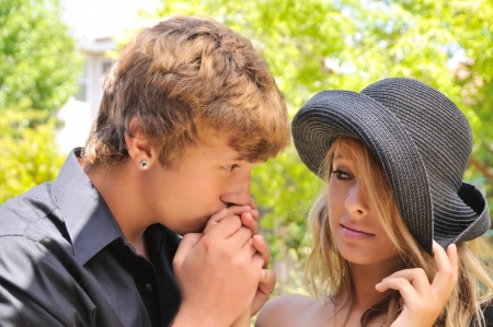 sorry: young man kissing a womans hand Stock Photo