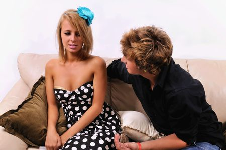 intrusive: man coming on to a seemingly uninterested woman on a couch