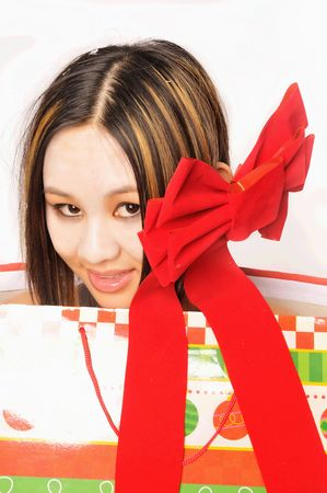 christmas shopping bag: Young Asian lady in a Christmas shopping bag