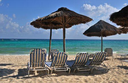 Palapas on a tropical beach in Playa Del Carmen Mexico