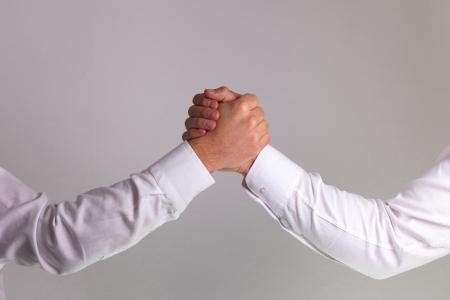 Hand shake between a businessman Stock Photo - 17870073