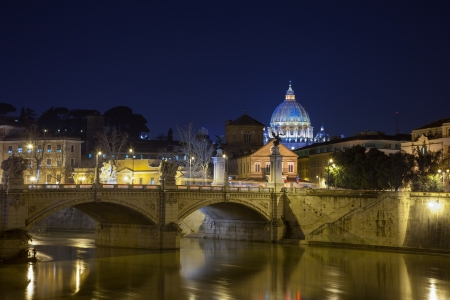 peter: A beautiful view to St. Peters basilica at night from the bridge Editorial
