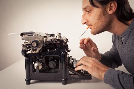 studio b: Man thinking at typewriter