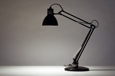 old office: Black desk lamp isolated on white