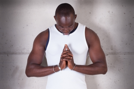 A black man praying photo