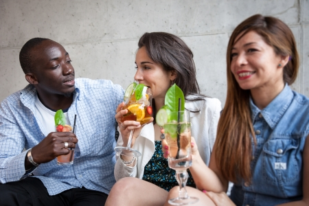 woman bar: Three young people with cocktail at bar