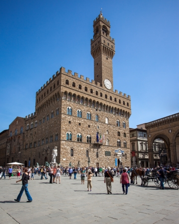 palazzo: FLORENCE, ITALY - MAY 4: Tourists visiting Palazzo Vecchio in Florence on May 4, 2013. Palazzo Vecchio is a World Heritage Site in Tuscany. Editorial