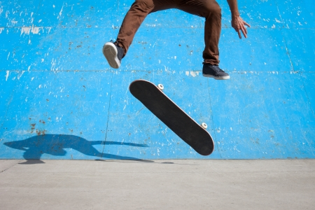 Skater jumps high in air under extrem-park photo