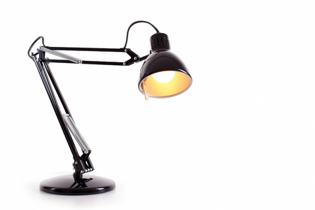 Vintage black desk lamp isolated on white photo