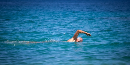 senior swimmer at sea photo