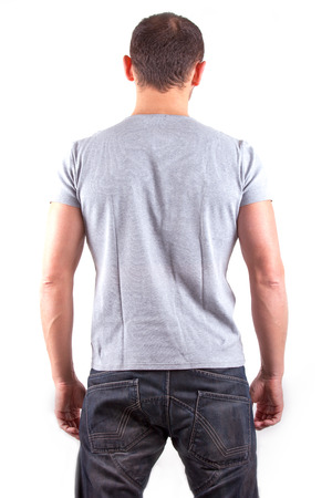 Backside view of young man isolated on white background