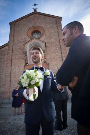 young groom waiting for his bride out of the church
