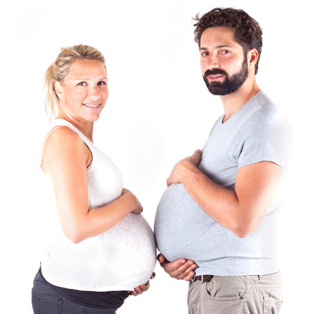 young pregnant couple showing big stomach Stock Photo