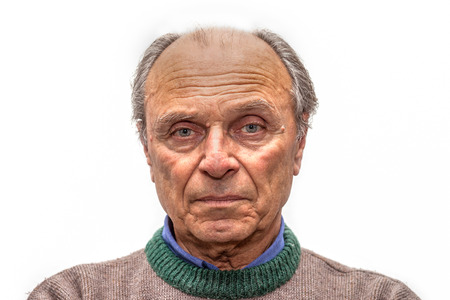 portrait of an old man with gray eyes Stock Photo