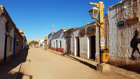 A street in San Pedro de Atacama with the typical adobe houses, Chile. Adobe house is a building material made from earth and organic materials.