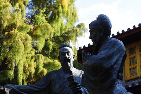 Lijiang, Yunnan, China - November, 2018. Statues in a square of Lijiang, Yunnan, China