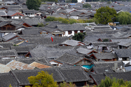 The roofs and tiles of the city of Lijiang, Yunnan, China Stock Photo