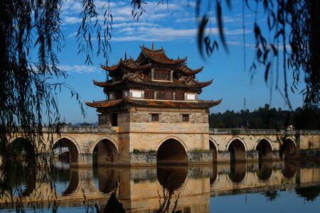 Old chinese bridge. The ancient Shuanglong Bridge (Seventeen Span Bridge) near Jianshui, Yunnan, China