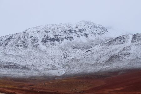 Landscape of mountains in the high lands of Chile near the border with Bolivia. Snow-covered landscapes of the Andes and the desert Zdjęcie Seryjne