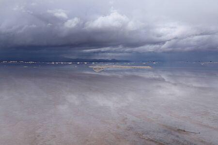 The Salar de Uyuni flooded after the rains, Bolivia. Clouds reflected in the water of the Salar de Uyuni, Bolivia Zdjęcie Seryjne