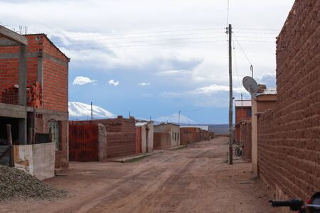 The village of Villa Alota with the snowy Andes mountains in the background, Bolivia