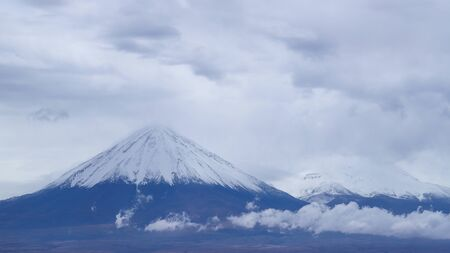 View of the Licancabur volcano covered by clouds, Atacama Desert, Chile