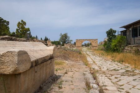 A sarcophagus and the Byzantine road. Al-Bass Tyre necropolis. Roman remains in Tyre. Tyre is an ancient Phoenician city. Tyre, Lebanon - June, 2019