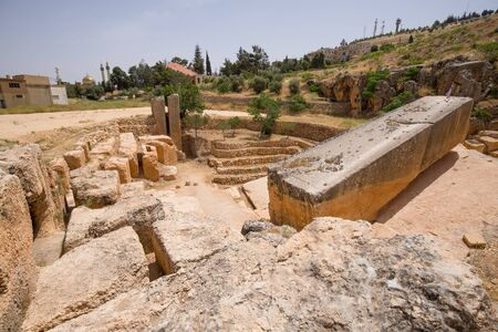 Ancient Roman quarry with a unfinished Roman monolith in Baalbek, Lebanon - June, 2019 스톡 콘텐츠 - 141873616